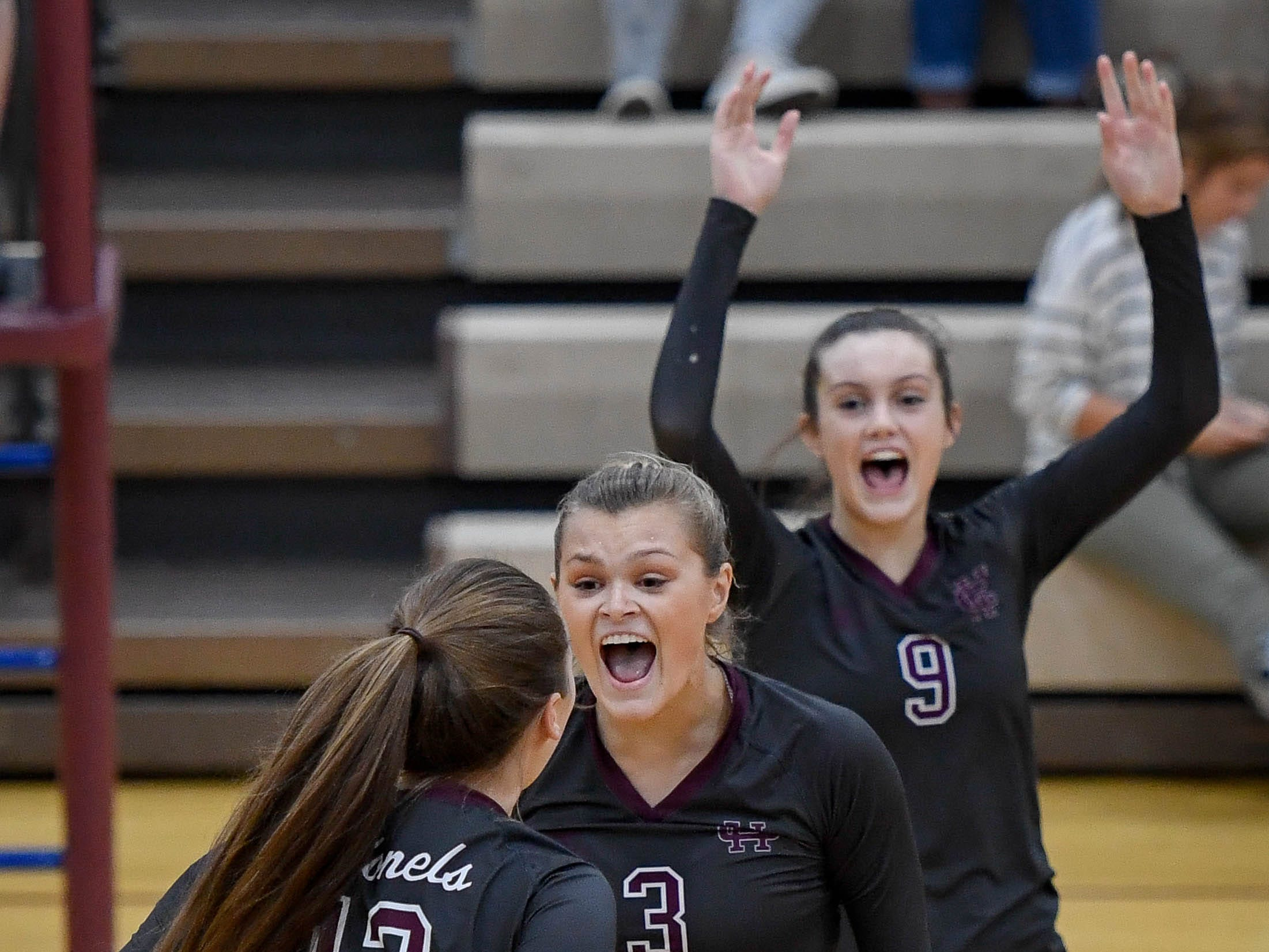 Henderson's Athena Sumner (13),  Hannah Watkins (3) and  Jordan Troutman (9) celebrate scoring a point as the Henderson County Lady Colonels play the Caldwell County Lady Tigers at Colonel Gym Thursday, October  4, 2018.