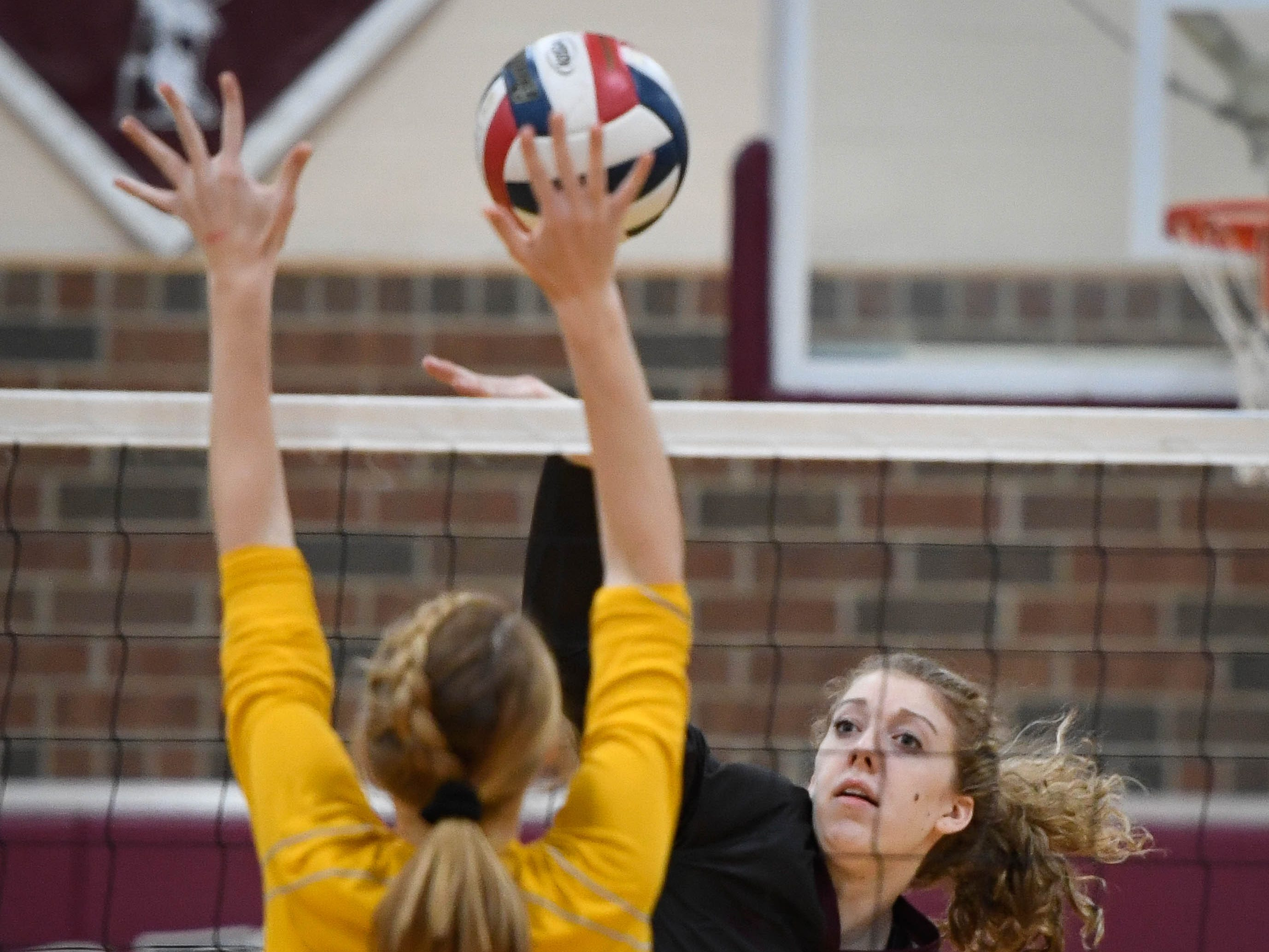 Henderson's Brooke Springer (2) shoots over the net at Caldwell's Abby Griggs (11) as the Henderson County Lady Colonels play the Caldwell County Lady Tigers at Colonel Gym Thursday, October  4, 2018.