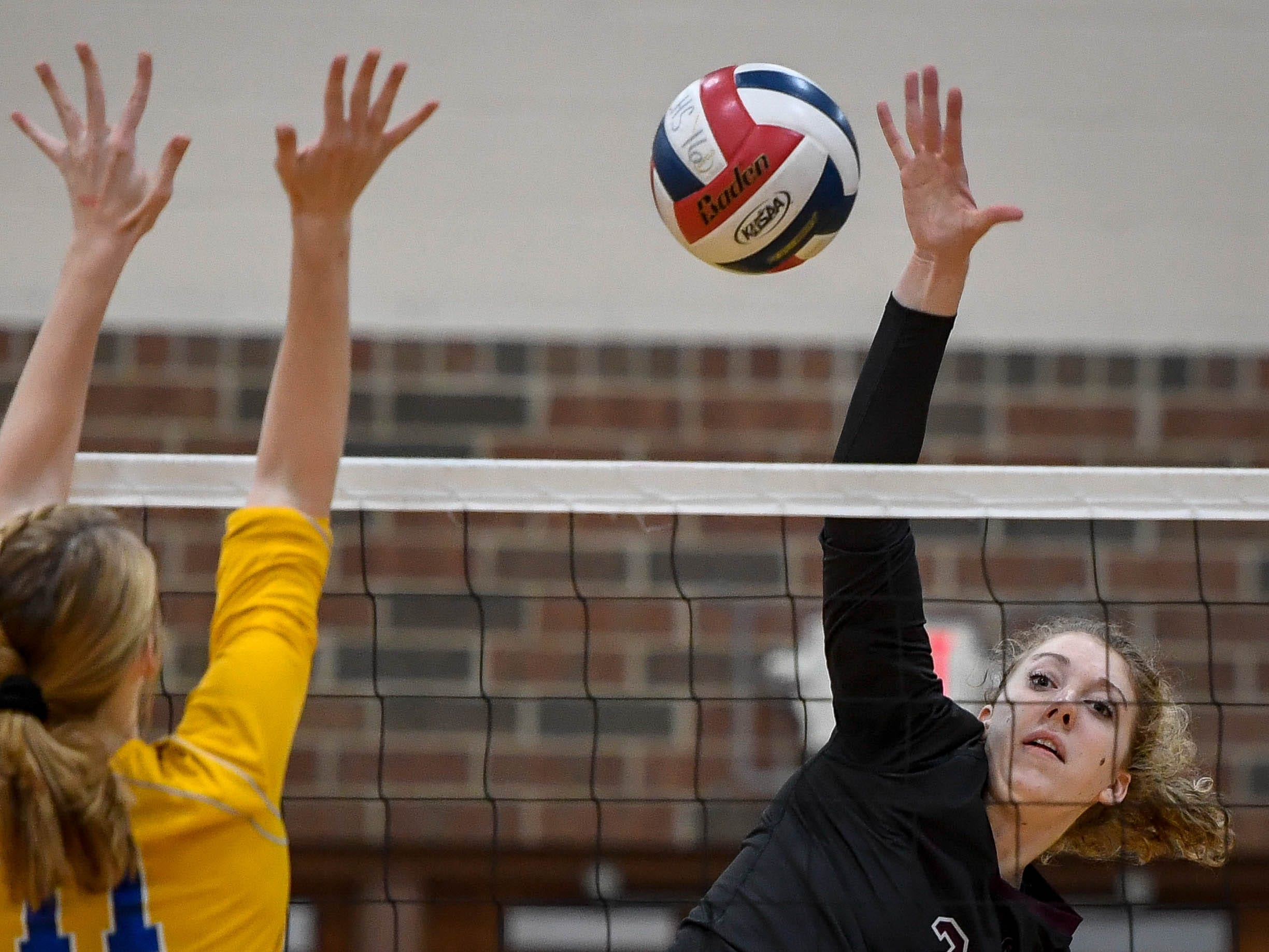 Henderson's Brooke Springer (2) fires a shot over the net against Coldwell's Abby Griggs (11) as the Henderson County Lady Colonels play the Caldwell County Lady Tigers at Colonel Gym Thursday, October  4, 2018.