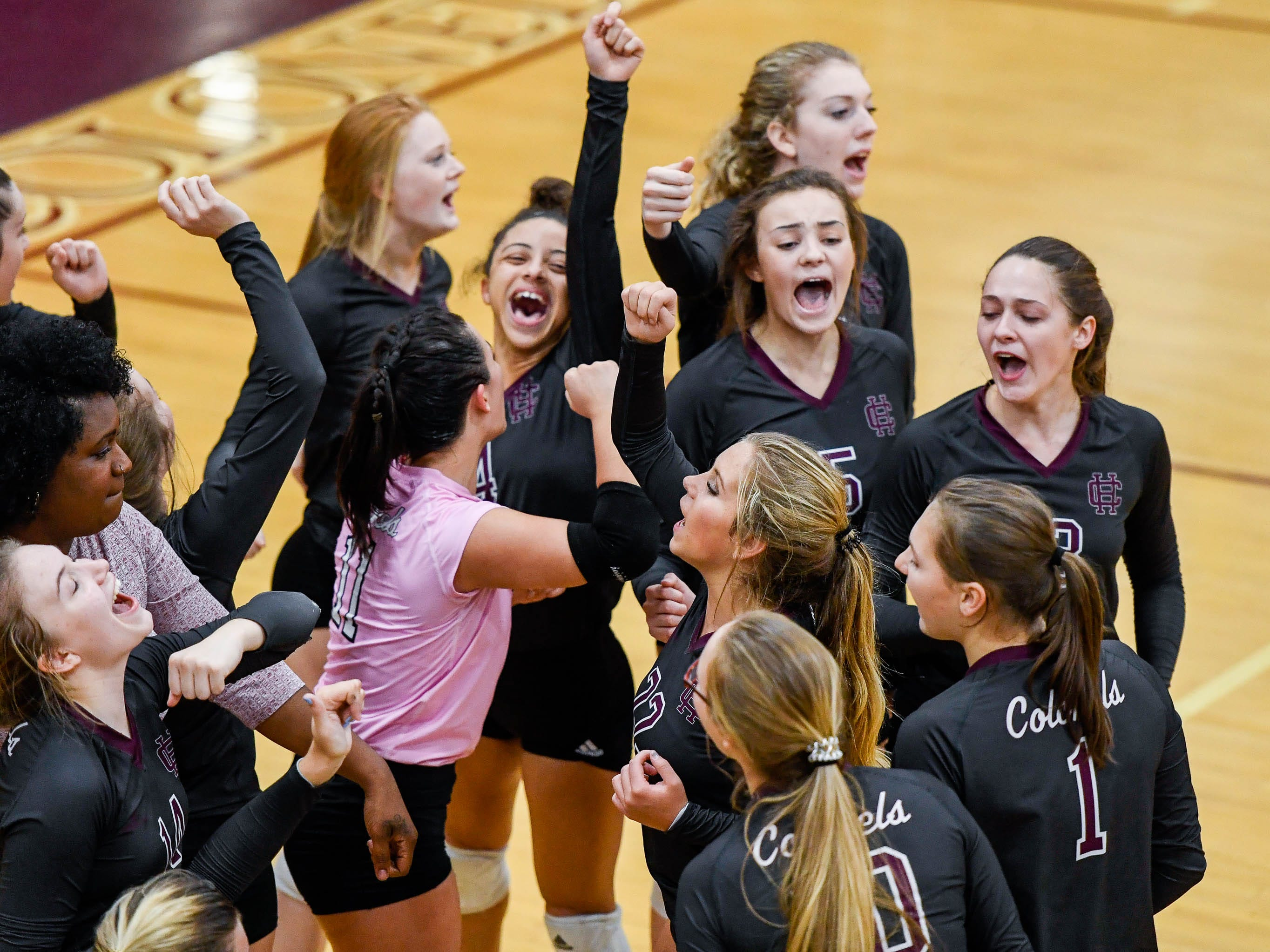 Henderson breaks a time-out huddle as the Henderson County Lady Colonels play the Caldwell County Lady Tigers at Colonel Gym Thursday, October  4, 2018.