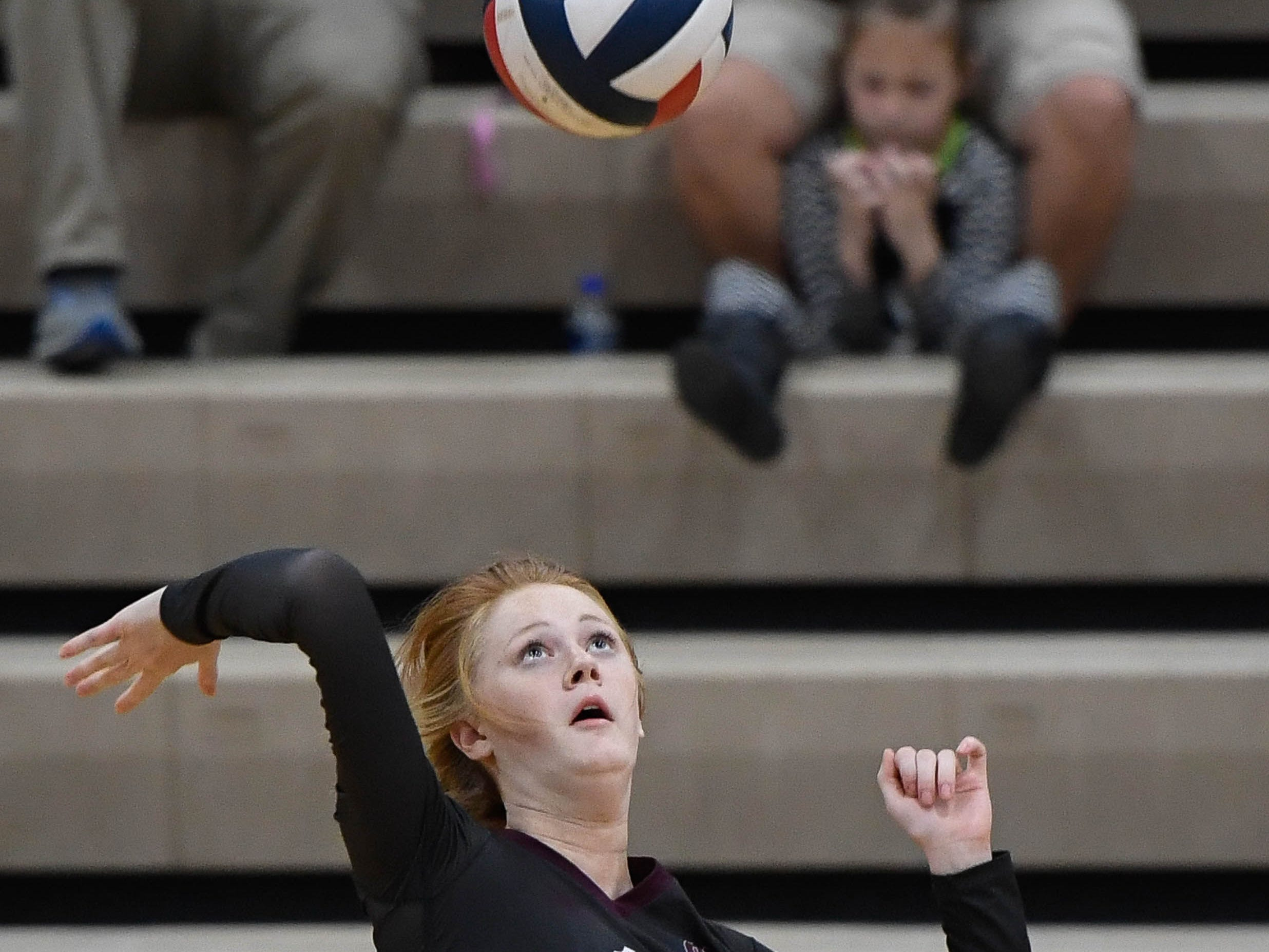 Henderson's Macala Walker (12) attacks as the Henderson County Lady Colonels play the Caldwell County Lady Tigers at Colonel Gym Thursday, October  4, 2018.