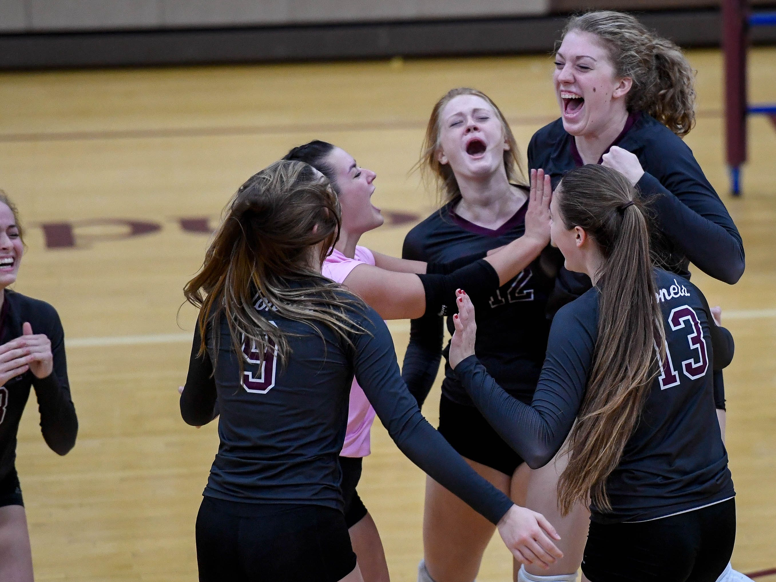The Colonel's celebrate a point late the the third match as the Henderson County Lady Colonels play the Caldwell County Lady Tigers at Colonel Gym Thursday, October  4, 2018.