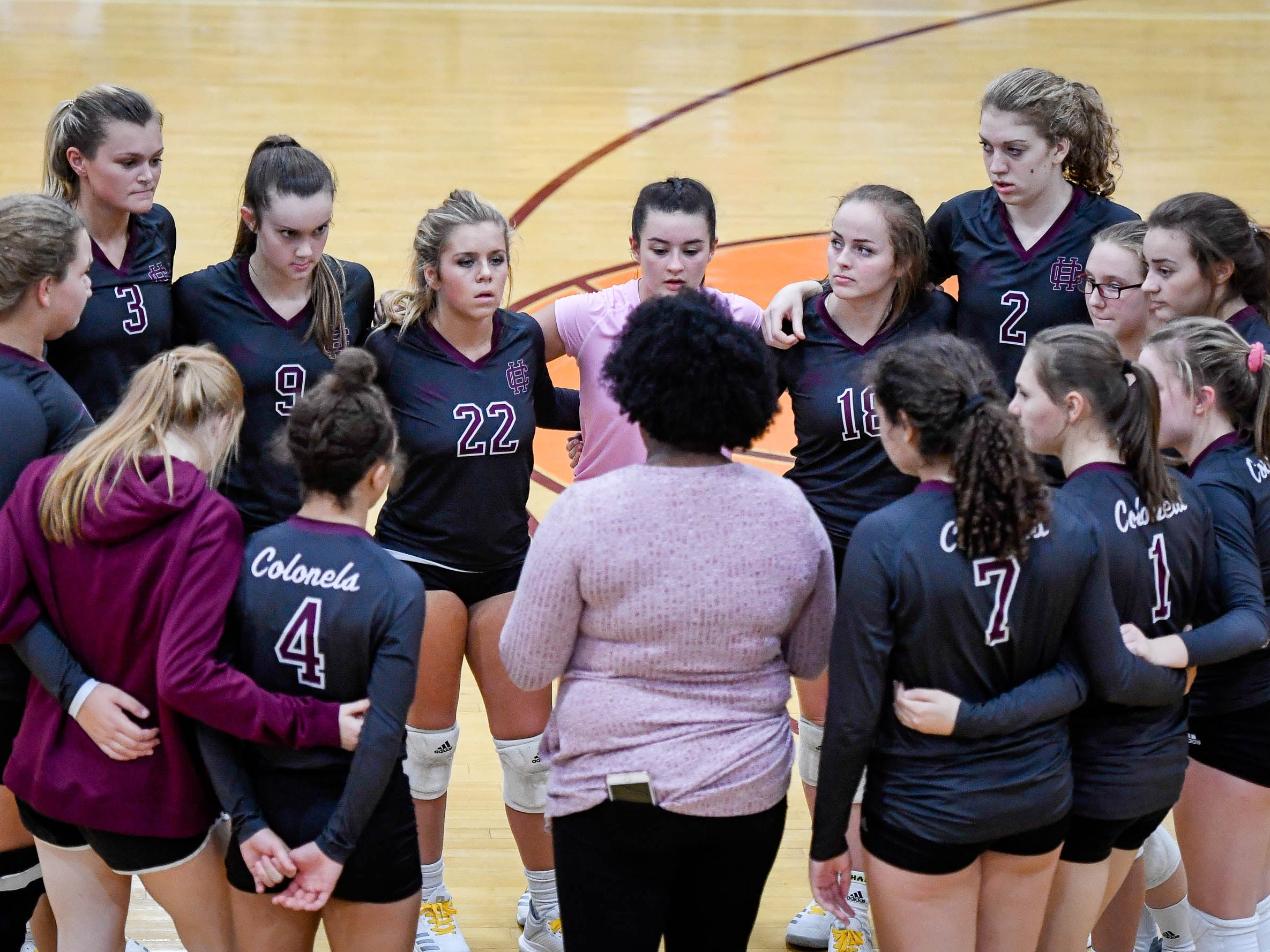 The team huddles with Henderson head coach Ashley Robinsonas the Henderson County Lady Colonels play the Caldwell County Lady Tigers at Colonel Gym Thursday, October  4, 2018.