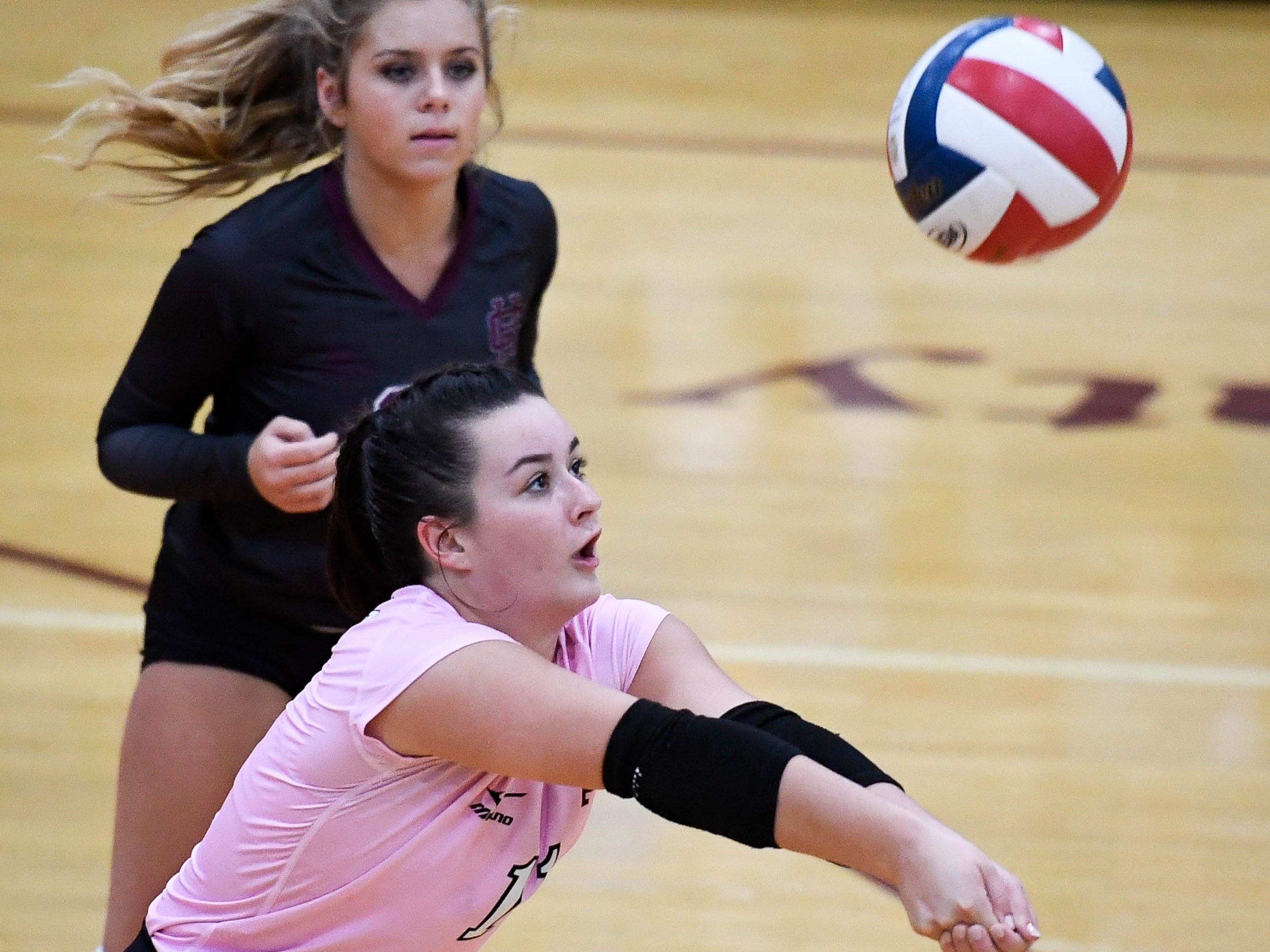 Henderson's Maggie Vincent (11) returns a serve as the Henderson County Lady Colonels play the Caldwell County Lady Tigers at Colonel Gym Thursday, October  4, 2018.