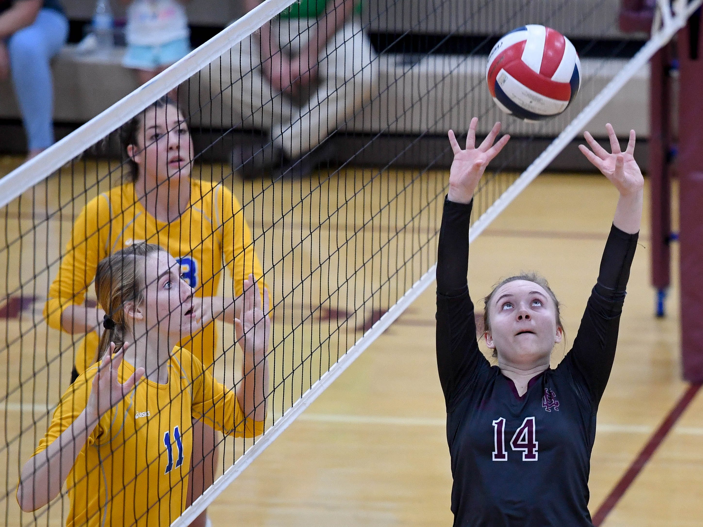 Henderson's Kaylee Norman (14) sets up the ball for a teammate as the Henderson County Lady Colonels play the Caldwell County Lady Tigers at Colonel Gym Thursday, October  4, 2018.