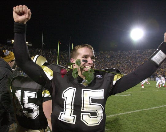 Quarterback Drew Brees had just two football scholarship offers coming out of high school: Kentucky and Purdue. He   clenched a rose in his teeth as he celebrated Purdue's 43-14 win over Indiana on Nov. 18, 2000. The victory earned Purdue an invitation to the Rose Bowl.