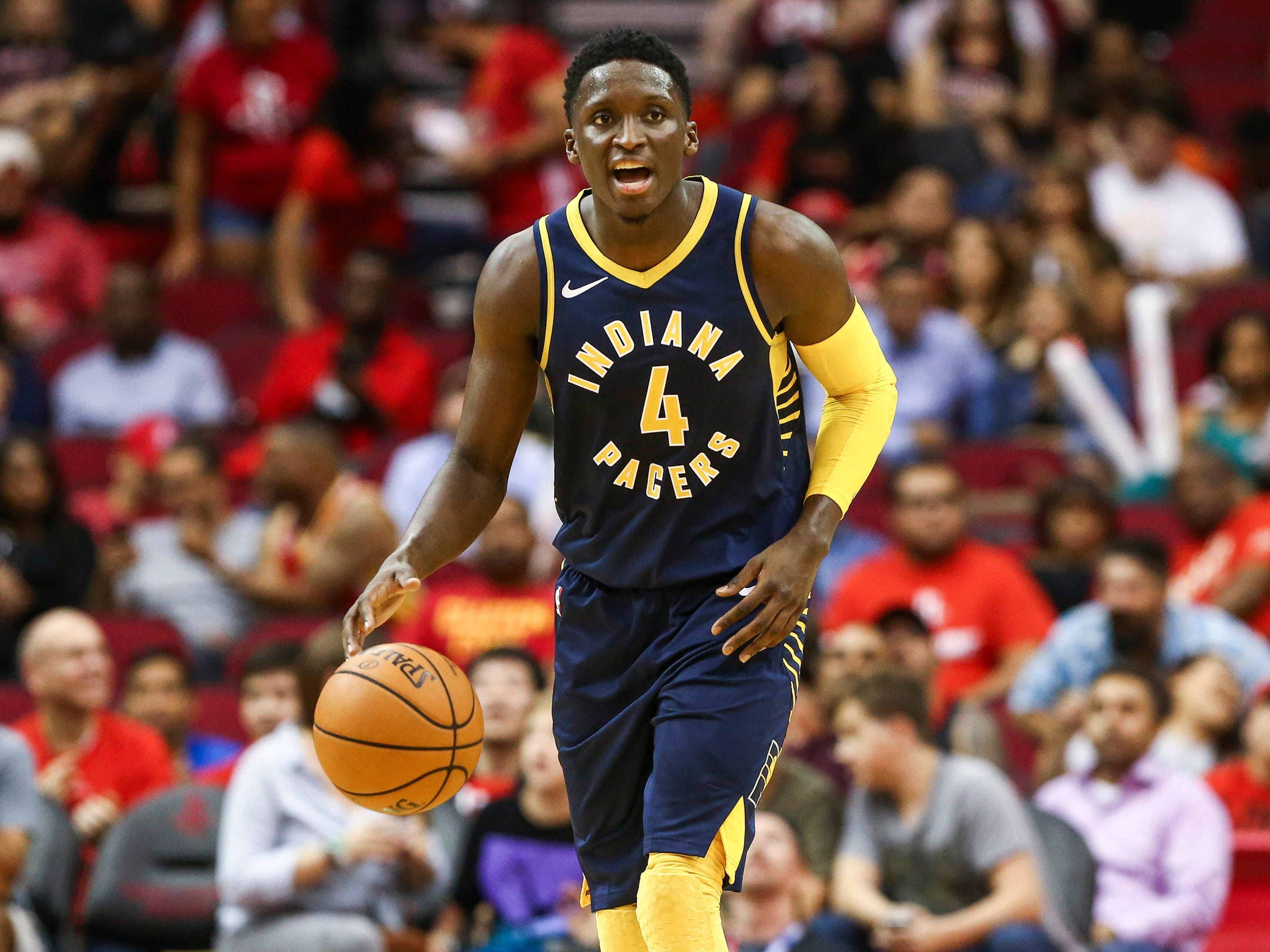 Indiana Pacers guard Victor Oladipo (4) dribbles the ball during the third quarter against the Houston Rockets at Toyota Center.