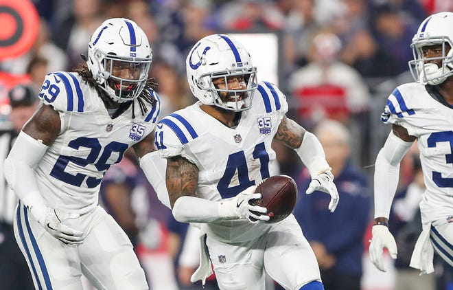 Indianapolis Colts safety Matthias Farley (41) celebrates his interception in the third quarter at Gillette Stadium in Foxborough, Mass., Thursday, Oct. 4, 2018.