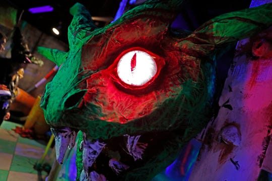 """A scary scene is seen at the """"Grim-nasium!"""" haunted house at the Children's Museum of Indianapolis, Friday, Oct. 5, 2018.  The sports-themed and creepy but popular haunted house runs Oct. 11-31, 2018, except for Mondays."""