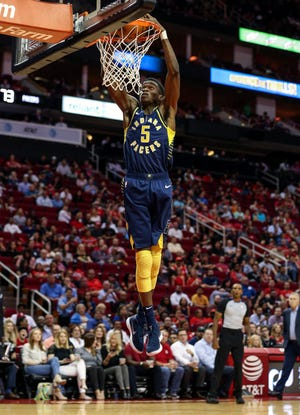 Oct 4, 2018; Houston, TX, USA; Indiana Pacers guard Edmond Sumner (5) dunks the ball during the third quarter against the Houston Rockets at Toyota Center. Mandatory Credit: Troy Taormina-USA TODAY Sports