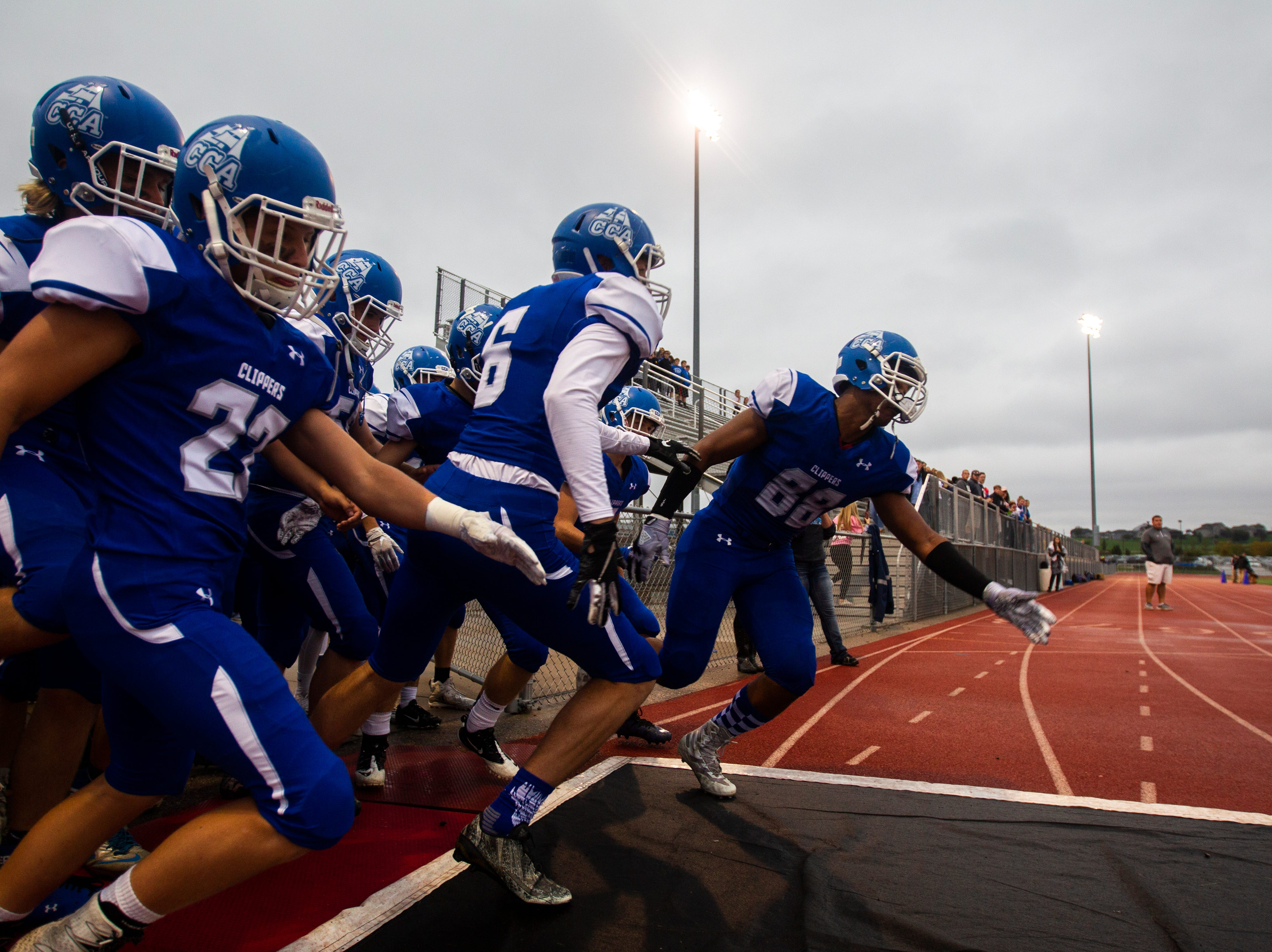 Clear Creek Amana's T.J. Bollers (88) leads his teammates onto the field during a Class 3A varsity football game on Friday evening, Oct. 5, 2018, at Clear Creek Amana Stadium in Tiffin, Iowa.
