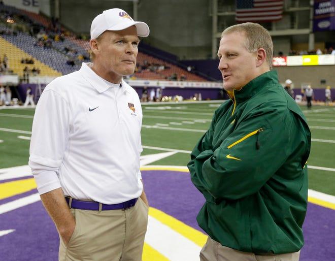 Northern Iowa coach Mark Farley talks with North Dakota State coach Chris Klieman before facing each other in 2014. Klieman is back in Cedar Falls Saturday as the Bison battle UNI.
