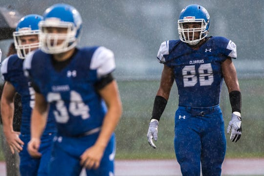 Clear Creek Amana's T.J. Bollers (88) looks to the sideline for a call in the pouring rain during a Class 3A varsity football game on Friday, Oct. 5, 2018, at Clear Creek Amana Stadium in Tiffin, Iowa.