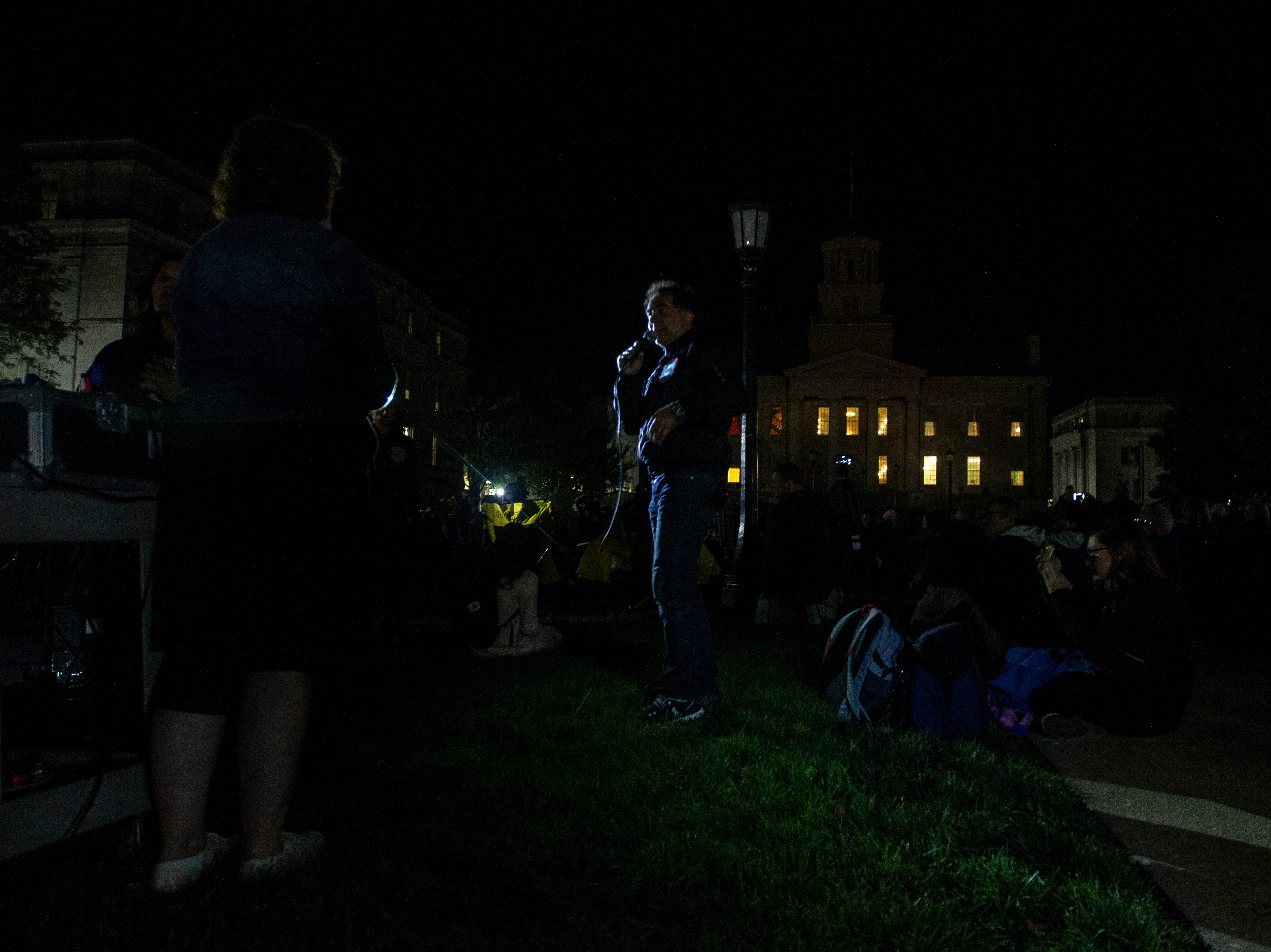 Gerry Hofstetter, a light artist, speaks before he projects images onto the Old Capitol on Thursday, Oct. 4, 2018, on the Pentacrest in Iowa City.