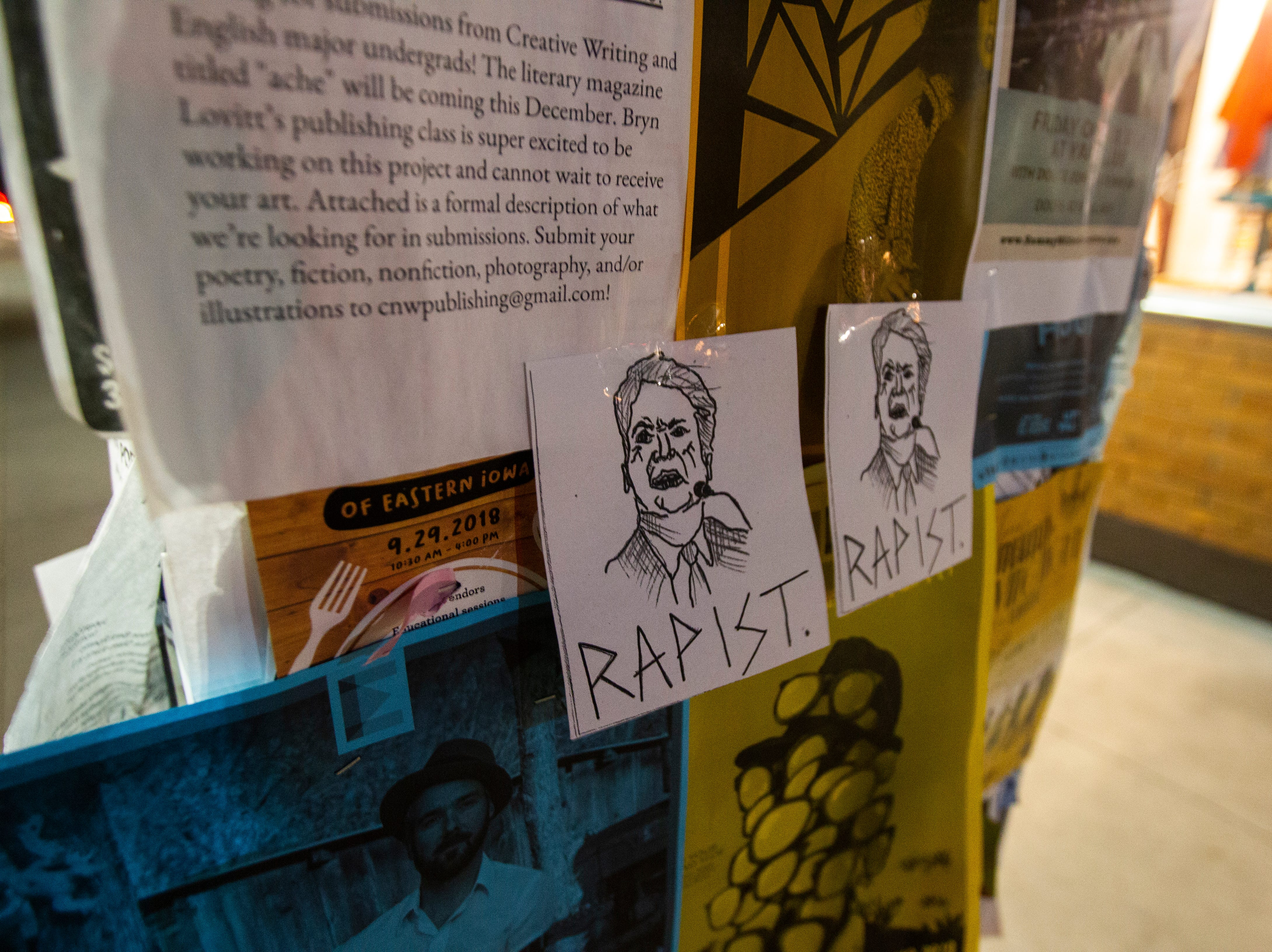 "Pieces of paper with an image of Supreme Court nominee Brett Kavanaugh with the word ""rapist"" below it on Thursday evening, Oct. 4, 2018, along Iowa Avenue in Iowa City."