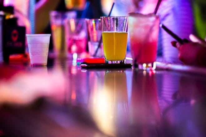 Drinks sit on a bar on Thursday evening, Oct. 4, 2018, in downtown Iowa City.