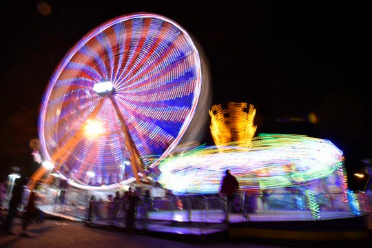 Long exposure photograph of a ferris wheel at the 158th Mississippi State Fair in downtown Jackson in October 2017.