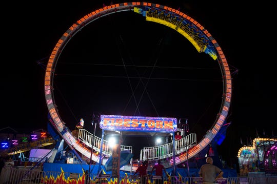 'FireStorm', or 'Ring of Fire', spins brave riders a full 360 degrees inside a vertical ring, both forwards and backwards. Wednesday, Oct. 3, 2018.