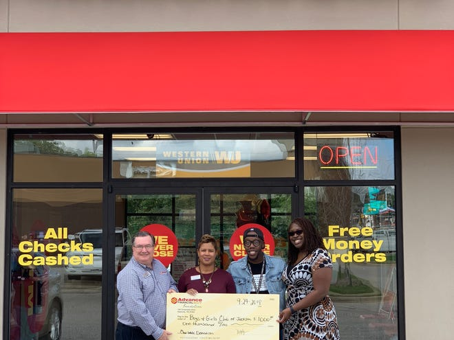 From left: Advance Financial Store Manager Steve Smith; VP, Corporate Citizenship Shantrelle Johnson; Boys and Girls Club Executive Assistant Elijah Shelton; and Director of Retail Operations Jessica Jackson.