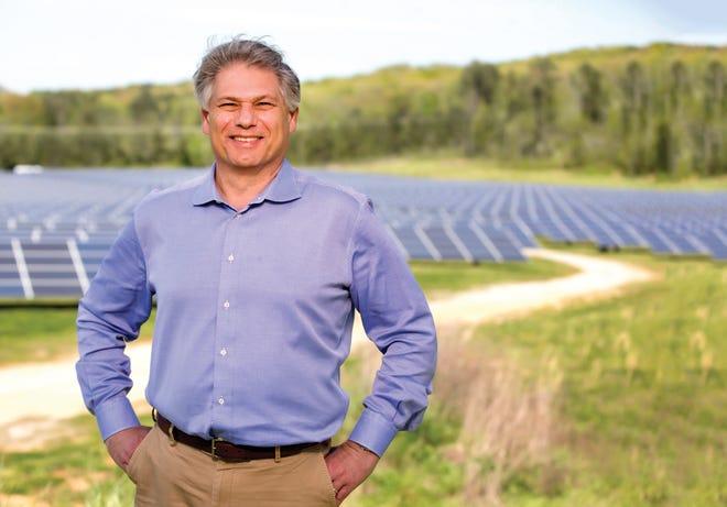 Matt Kisber stands before the Solar farm at VW assembly plant in Chattanooga, Tenn.
