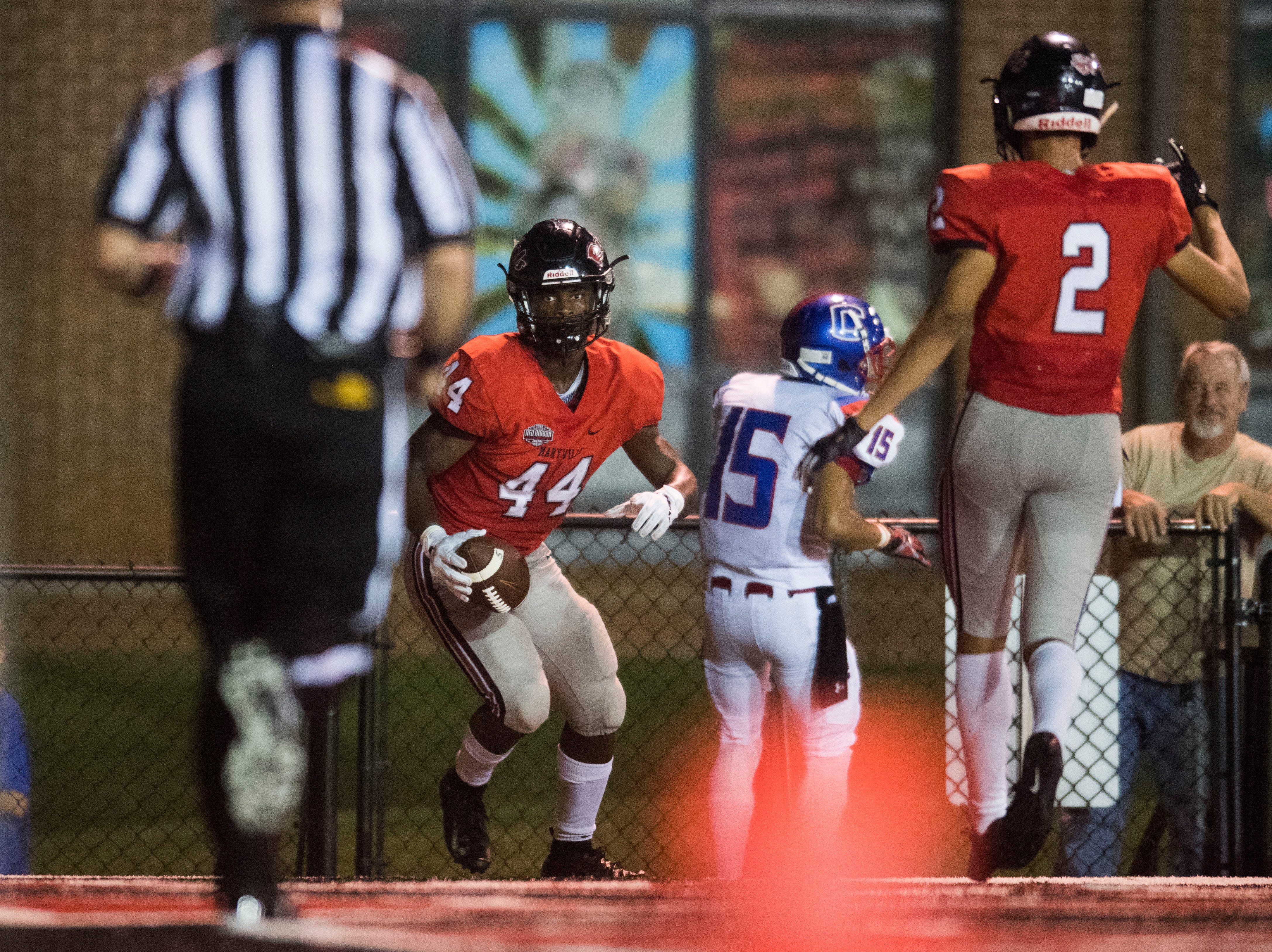 Maryville's Tee Hodge (44) makes a touchdown during a game between Cleveland and Maryville at Maryville Thursday, Oct. 4, 2018. Maryville defeated Cleveland 42-7.