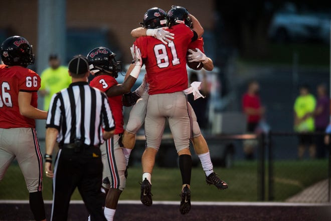 Maryville's Bryson Teffeteller (21) celebrates his touchdown with teammate Brody Sloan (81) during a game between Cleveland and Maryville at Maryville Thursday, Oct. 4, 2018. Maryville defeated Cleveland 42-7.