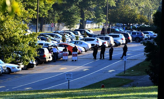 Law enforcement officers remove equipment in the parking lot at Bearden High School after a morning of random weapon checks Friday, Oct. 5, 2018.