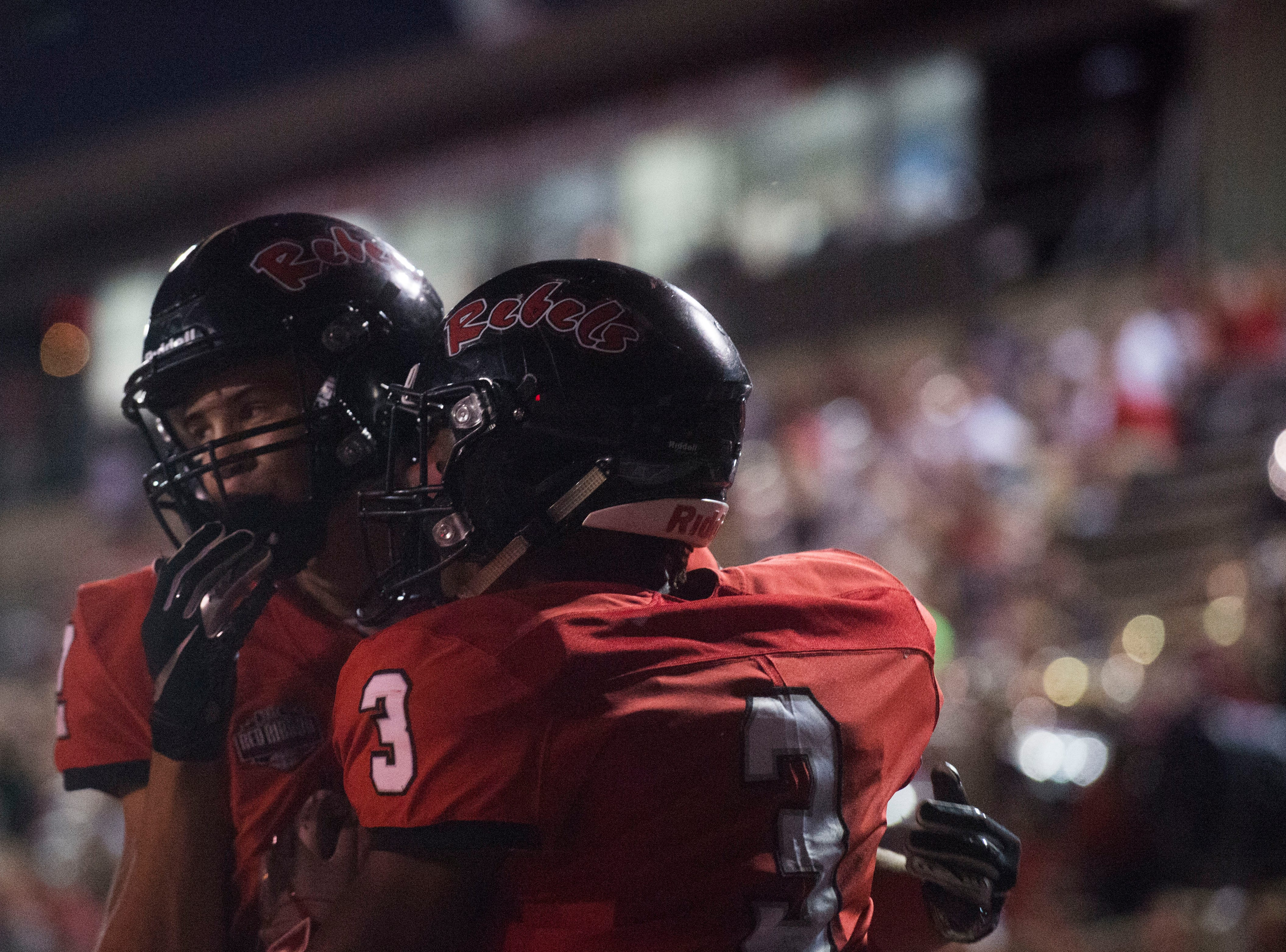 Maryville's A.J. Davis (3) celebrates with Maryville's Ashton Maples (2) after his touchdown during a game between Cleveland and Maryville at Maryville Thursday, Oct. 4, 2018. Maryville defeated Cleveland 42-7.