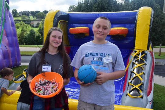 Kasey Bersin, 13, and Logan Cruze, 15, man the inflatables making them safe for the little kids at the Family Fun Day and Street Festival held at Hardin Valley Free Will Baptist Church Saturday, Sept. 29.