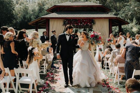 AJ and Madison Kolonis walk down the aisled at their wedding at Dara's Gardens. (submitted by Dara Bozdogan)