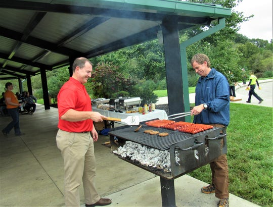 Staffers David Smoak and Mark Shipley manned the grill at the Town of Farragut employees' picnic on Sept. 28. Employees got to take a couple of hours off and enjoy a cornhole tournament, football toss and lunch at McFee Park.