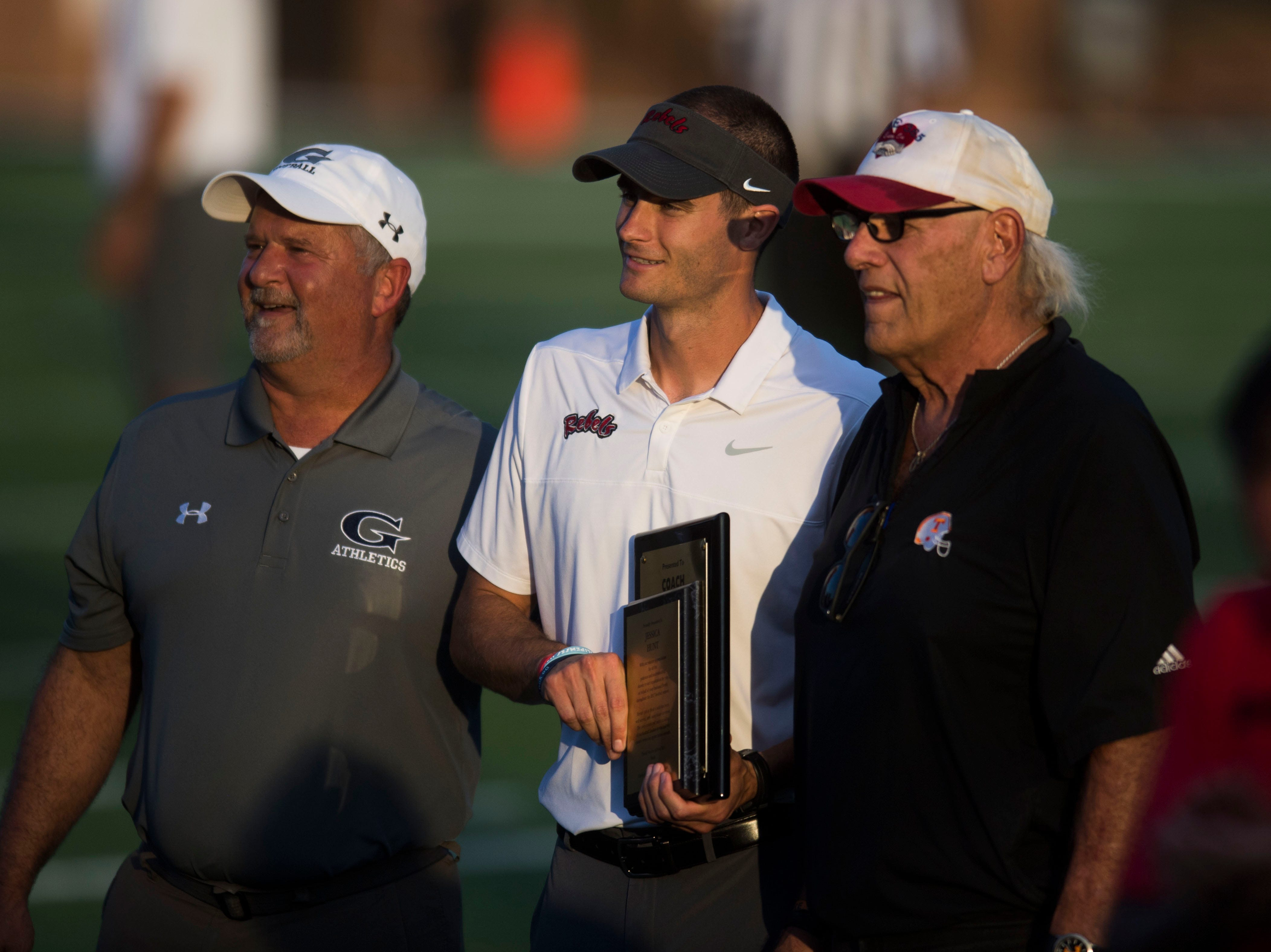 Maryville Head Coach Derek Hunt accepts an award before a game between Cleveland and Maryville at Maryville Thursday, Oct. 4, 2018. Maryville defeated Cleveland 42-7.