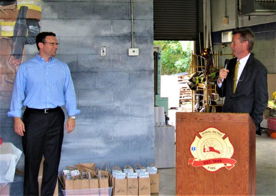 Host Jason Zachary introduced speaker Tim Burchett during First Responders Appreciation Day at Rural Metro Fire Station 41on North Campbell Station Road.