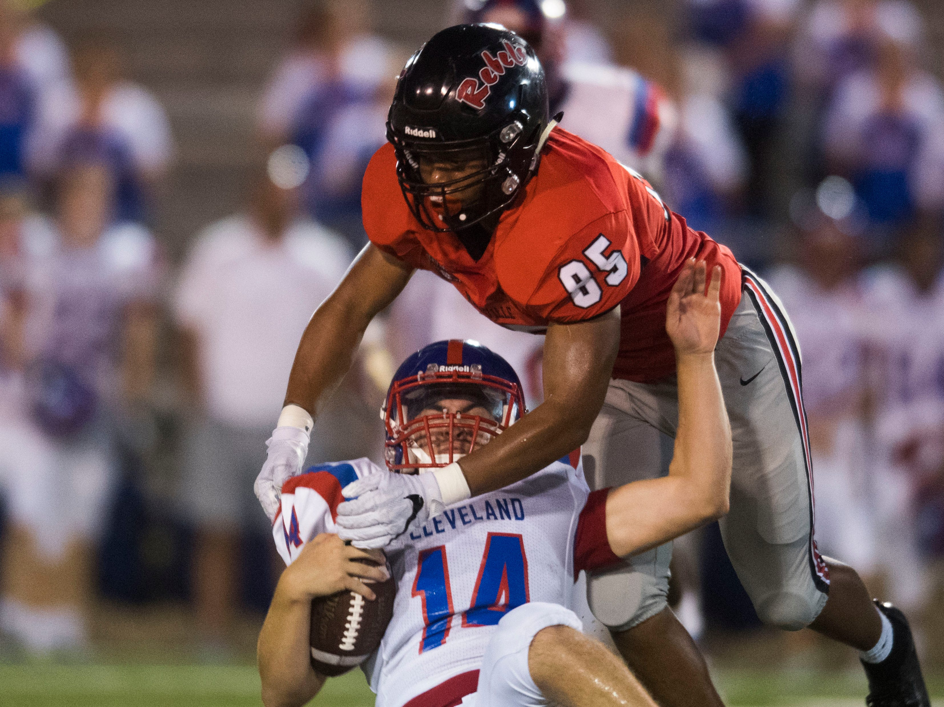 Cleveland's Jackson Moore (14) slides to avoid a tackle by Maryville's Matthew Brooks (85) during a game between Cleveland and Maryville at Maryville Thursday, Oct. 4, 2018. Maryville defeated Cleveland 42-7.