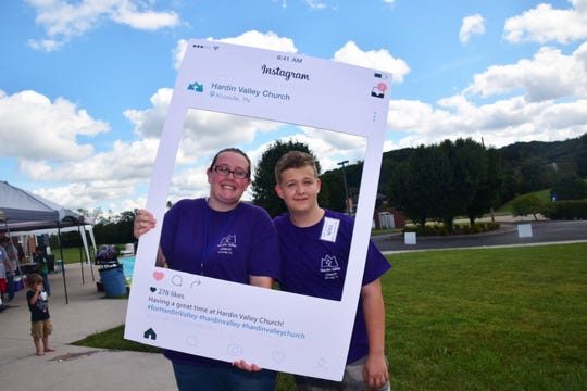"Kristi Biffin, and Will Skinner, 13, take a pause for an ""Instagram"" photo at the Family Fun Day and Street Festival held at Hardin Valley Free Will Baptist Church Saturday, Sept. 29."