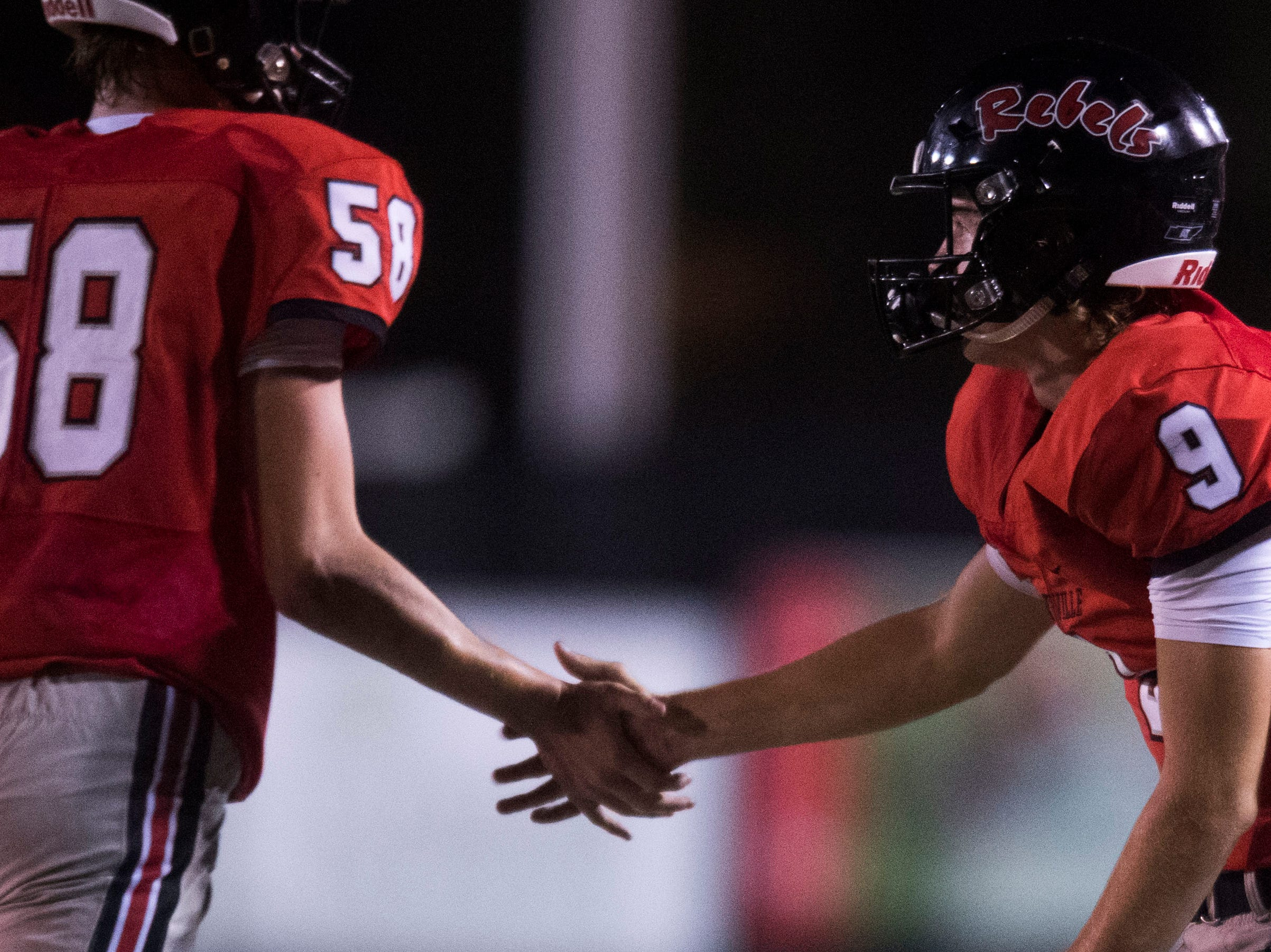 Maryville's Cade Chambers (9) high fives Maryville's Mason Hobby (58) during a game between Cleveland and Maryville at Maryville Thursday, Oct. 4, 2018. Maryville defeated Cleveland 42-7.