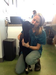 Isabella gets a cuddle from Dr. Leah Wulforst at Riverside Veterinary Clinic, October 3, 2018.