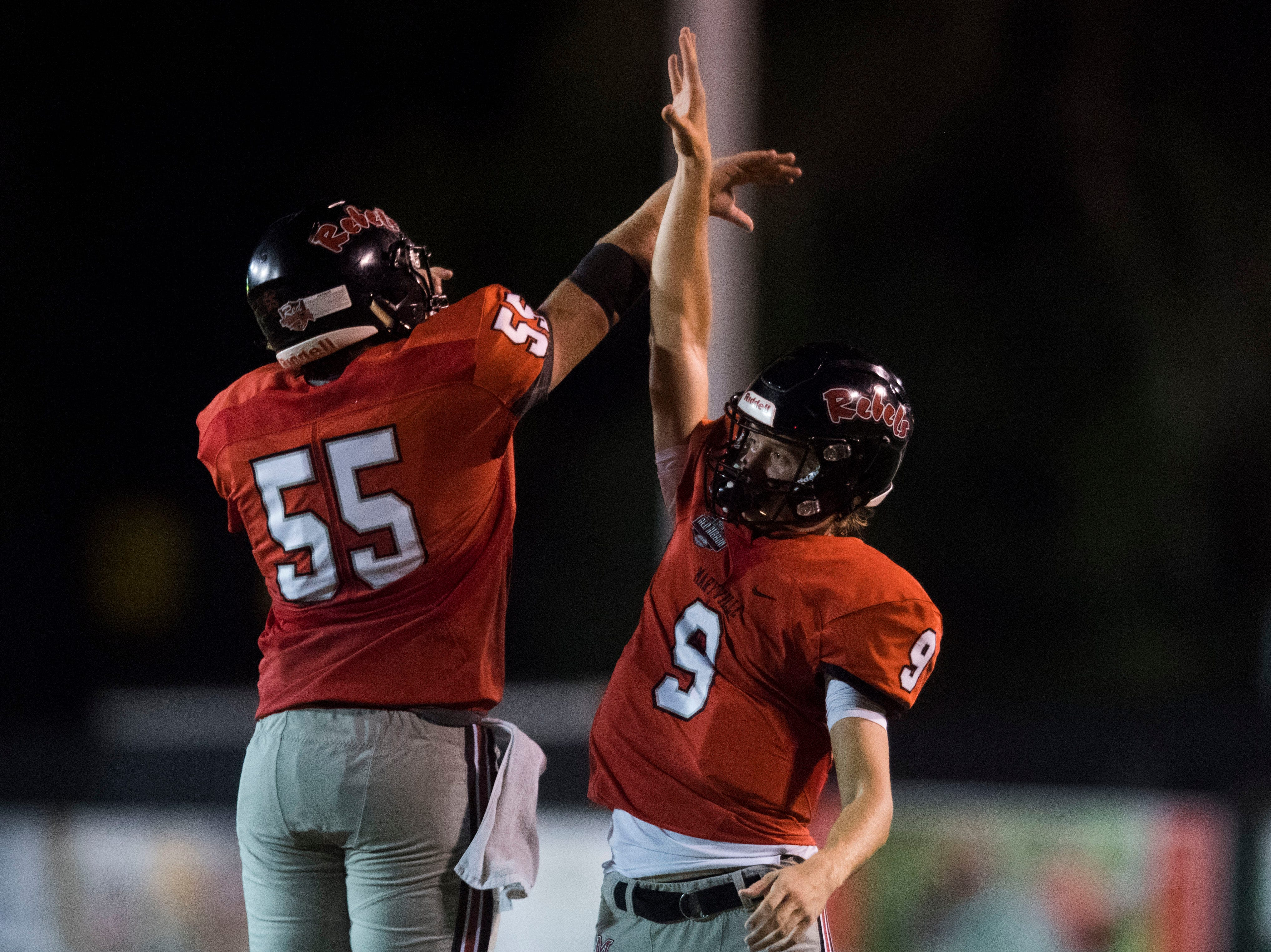 Maryville's William Harding (55) and Maryville's Cade Chambers (9) celebrate a play during a game between Cleveland and Maryville at Maryville Thursday, Oct. 4, 2018. Maryville defeated Cleveland 42-7.