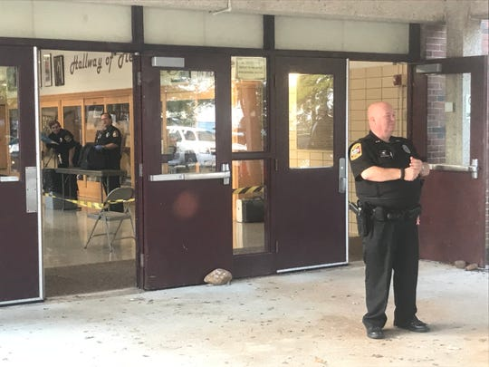 Law enforcement manned the front of Bearden High School on Friday morning and searched backpacks as students arrived.