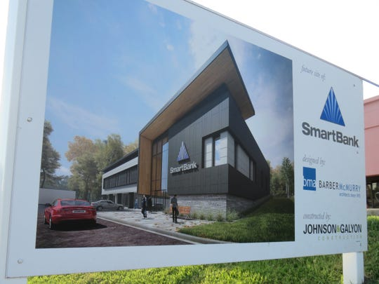 Sign shows architectural rendering of BarberMcMurry-designed SmartBank on Kingston Pike.