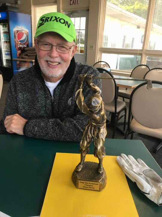 """Duane Garver shows a gag trophy on Oct. 4, 2018 for the """"Dong Tam Invitational"""" a championship created in 1972. Garver saved the life of a pilot, left for dead, and the two men became lifelong friends."""