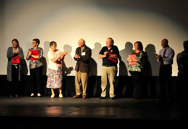 Recipients of this year's Red Cross Hero awards assemble on the stage of the Renaissance Theatre on Thursday evening.