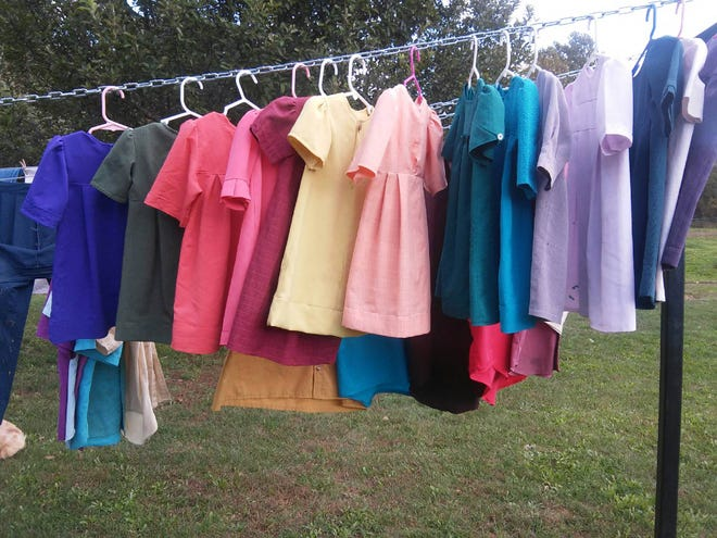 These homemade dresses in rainbow colors are drying on a line outside after washing. They belongtoLovina's 2-year-old granddaughterAbigail.