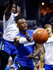 Kyvon Davenport makes a pass during Memphis Madness at the FedExForum Thursday evening.
