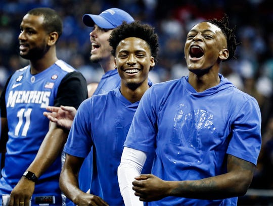 Jayden Hardaway (middle) and Kyvon Davenport (right) during Memphis Madness at the FedExForum Thursday evening.