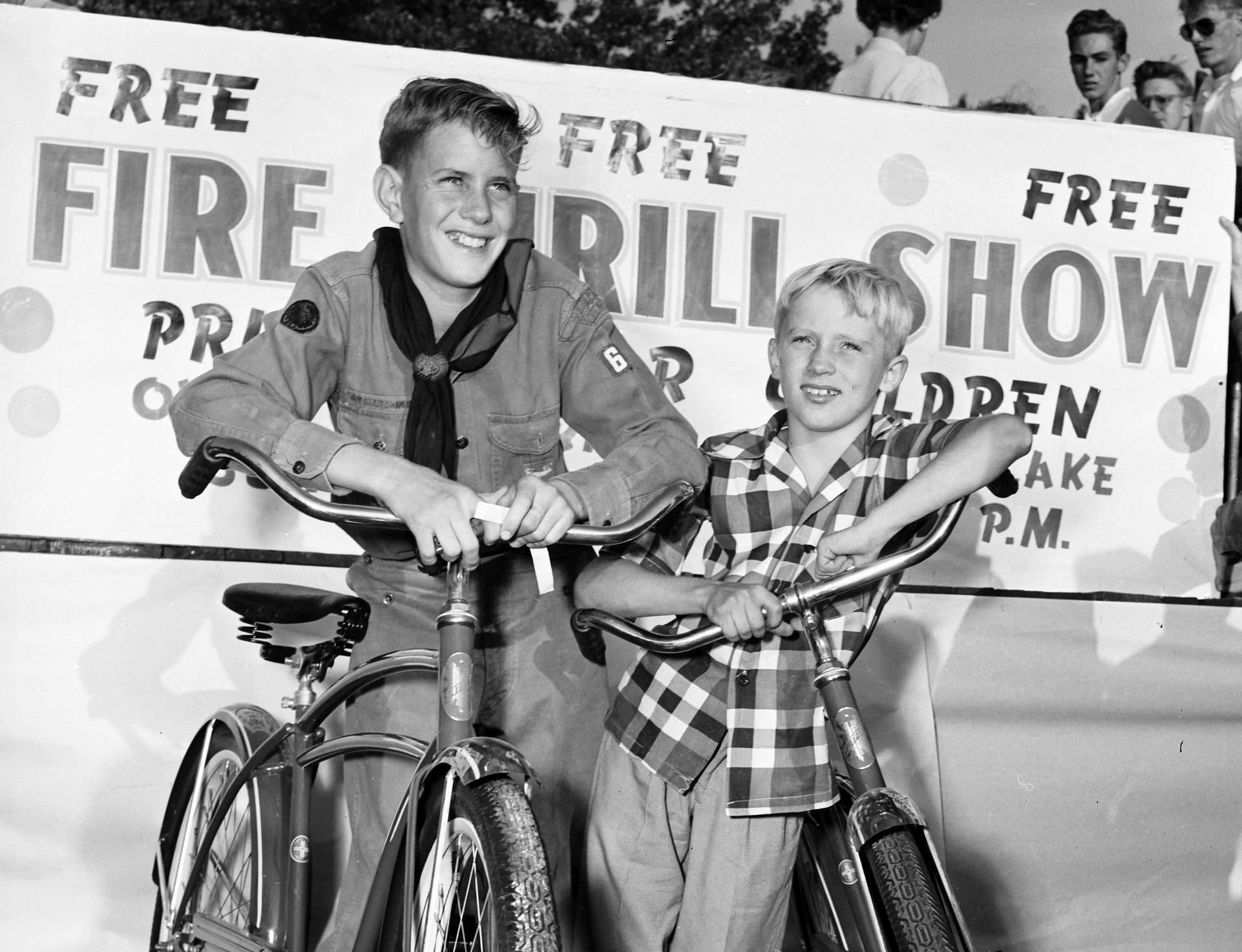 Melvin Dulin, 14 year-old Explorer Scout and Bobby Barnett, 10, found the hidden toy fire engines carrying the biggest prizes — brand new bicycles.  They were among hundreds of youngsters who searched for the engines during Fire Prevention Week during the first week of October 1952.  Each engine bore a fire prevention slogan.  Melvin  is the son of Mr. and Mrs. Gray W. Dulin of 3422 Mayflower.  Bobby is the son of Mr. and Mrs. Lafayette Barnett of 1642 Sailors.  The contest was sponsored by the Recreation Department.