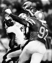 May 11, 1984 - Memphis Showbotas defensive end Reggie White (#92) closes in on San Antonio quarterback Rick Neuheisel during a May 11, 1984 game at Liberty Bowl Memorial Stadium. (Staff Photo by Dave Darnell)