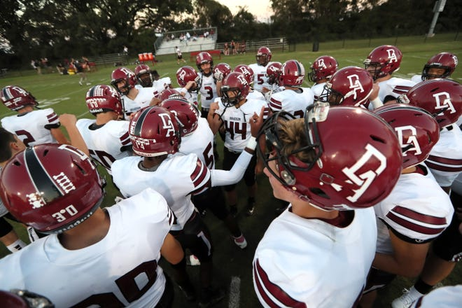 Davidson Academy players huddle up before their game against Fayette Academy on Thursday.