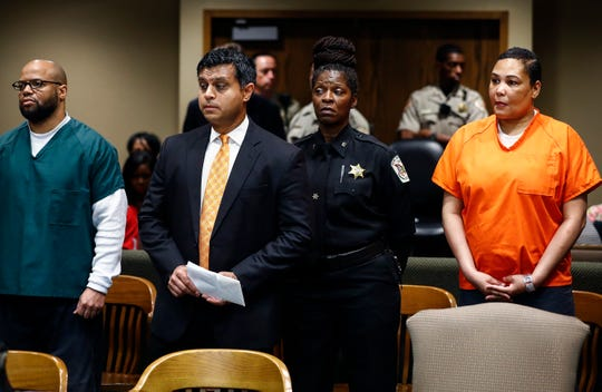 Sherra Wright's attorney Juni Ganguli (middle) makes an appearance in Judge Lee V. Coffee's courtroom Friday. Wright (right) and co-defendant Billy Ray Turner (left) are charged with killing her ex-husband NBA star Lorenzen Wright.