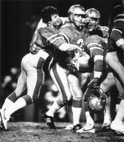 March 31, 1984 - Memphis Showboats' Alan Duncan (center) is surrounded by teammates, including Cormac Carney (left), after Duncan kicked a 32-yard field goal in the final seconds of the game to give Memphis a 27-24 victory over the Jacksonville Bulls.